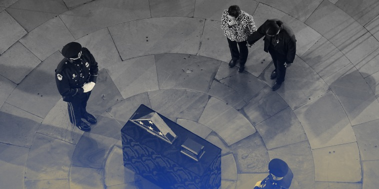Image: People mourning during a ceremony for Capitol officer Brian D. Sicknick in the Rotunda of the U.S. Capitol.