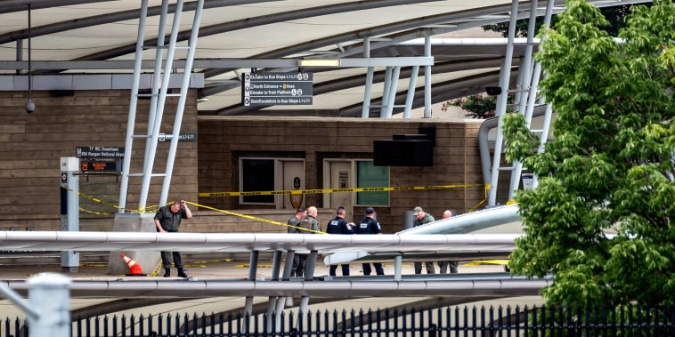 Image: A police officer passes underneath barrier tape outside the Pentagon Metro area on Aug. 3, 2021, at the Pentagon in Washington.