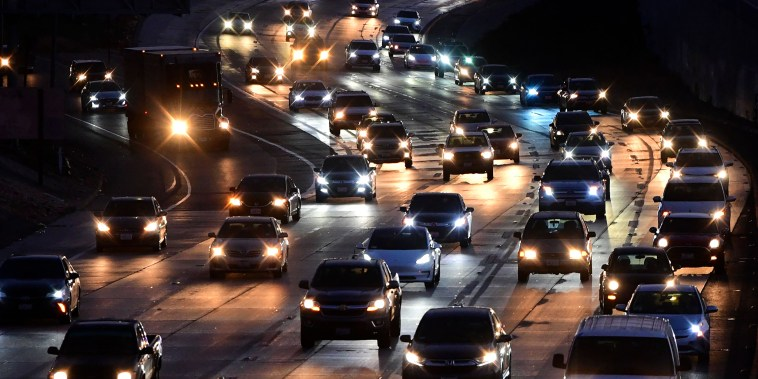 Vehicles head east out of Los Angeles on the Interstate 10 freeway in Alhambra, Calif., on May 27, 2021.