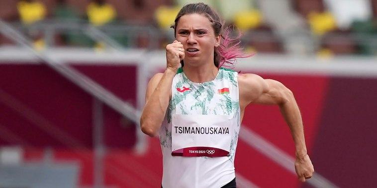 Image: Krystsina Tsimanouskaya, of Belarus, runs in the women's 100-meter run at the Tokyo Olympics on July 30, 2021.