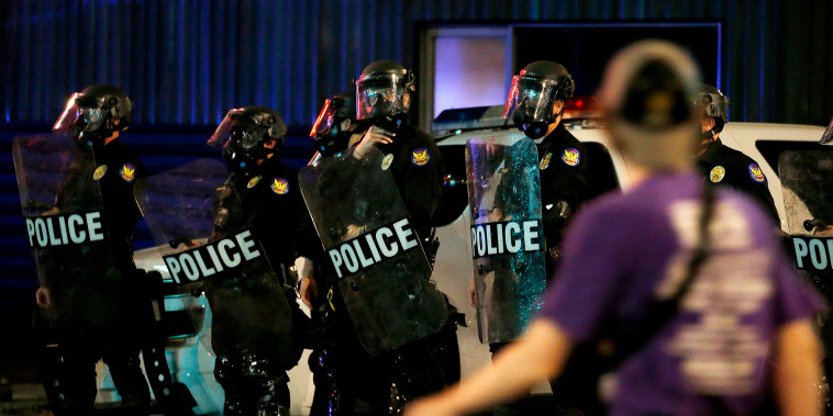 Phoenix Police keep protesters away from Phoenix Police Headquarters on  May 30, 2020, in Phoenix.