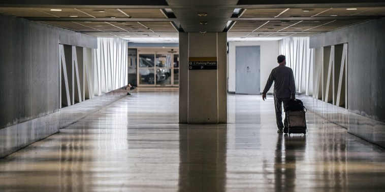 A traveller walks through the George Bush Intercontinental Airport on Aug. 5, 2021 in Houston, Texas.