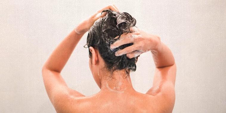 Woman Washing Hair In Bathroom At Home