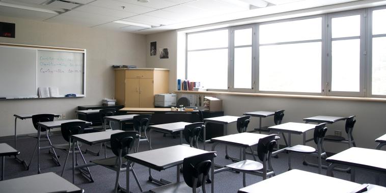 Empty desks in a well-lit classroom