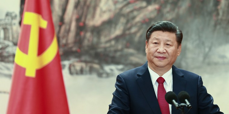Image: Chinese President Xi Jinping speaks at the podium during the unveiling of the Communist Party's new Politburo Standing Committee at the Great Hall of the People in Beijing.