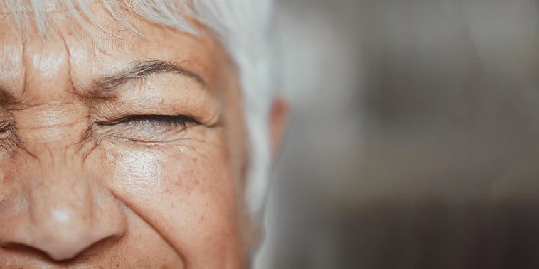 Closeup of excited senior woman with eyes closed, smiling