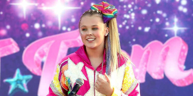 """JoJo Siwa performs onstage during a drive-in screening and performance for the Paramount+ original movie """"The J Team"""" at the Rose Bowl on September 03, 2021."""