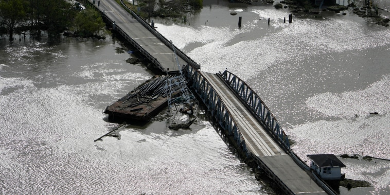A barge damages a bridge that divides Lafitte, La., and Jean Lafitte, in the aftermath of Hurricane Ida, on August 30, 2021.