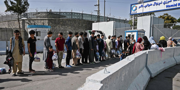 Image: Afghans, hoping to leave Afghanistan, queue at the main entrance gate of Kabul airport in Kabul on Aug. 28, 2021, following the Taliban military takeover of Afghanistan.