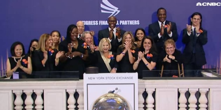 Cynthia DiBartolo (c), rings the bell during the NYSE closing auction on July 8, 2021.