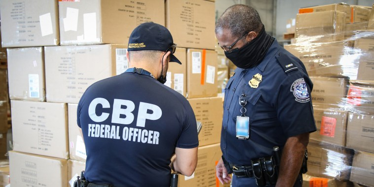 CBP officers in Atlanta inspect apparel suspected to be made with cotton harvested by forced labor in China's Xinjiang Region, August 2021.