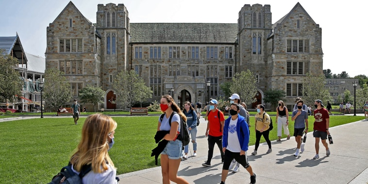 Mask-wearing students on the Boston College campus in Chestnut Hill, Mass., on Sept. 14, 2020.
