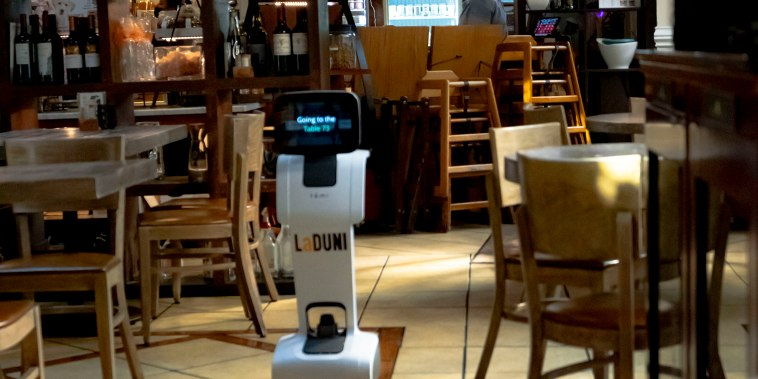 One of the robots at La Duni roams the restaurant.