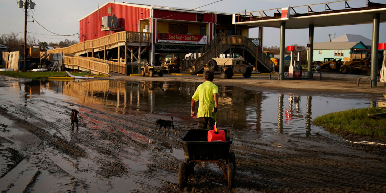 A man goes for gas at a hurricane-damaged gas station in the aftermath of Ida on Sept. 6, 2021, in Grand Isle, La.
