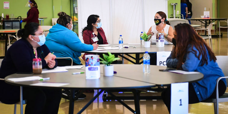 Propspective employees are interviewed during a job fair at AltaMed Health Services on July 9, 2021 in Huntington Park, Calif.