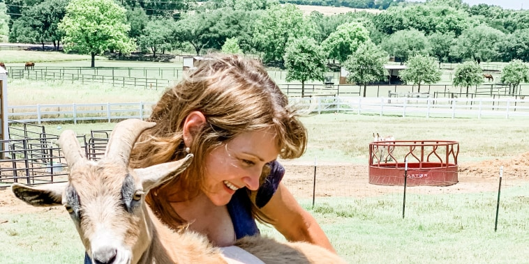 Shannon McLinden, CEO of FarmHouse Fresh, taking an injured goat to a veterinarian's office.