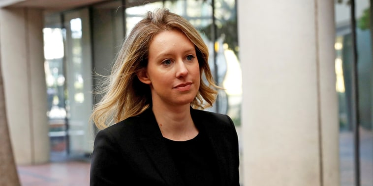 Image: Elizabeth Holmes arrives for a hearing at a federal court in San Jose