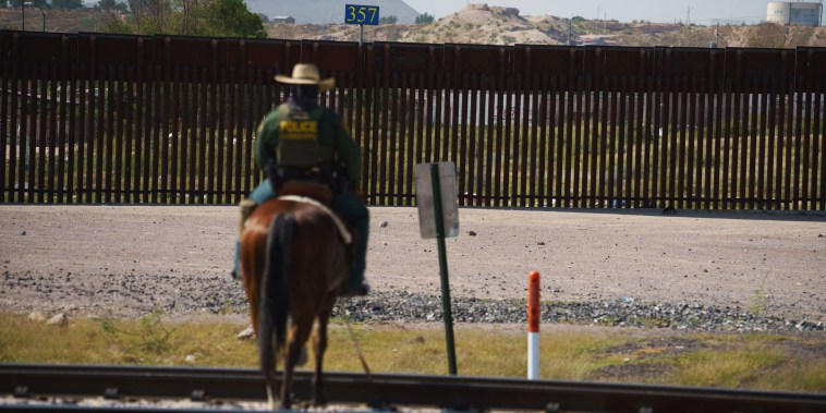 A border patrol agent patrols on horseback in Sunland Park, N.M., on Sept. 9, 2021.