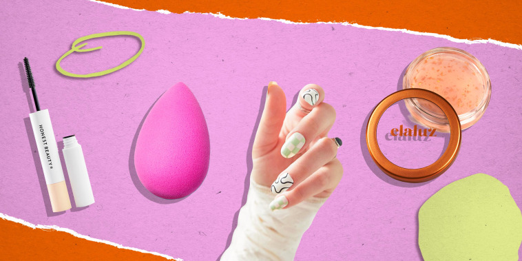 Illustration of a BeautyBlender, Elaluz 24K Lip Therapy, hand with Chillhouse Chill Tips Press-On Manicure Kit and Honest Beauty 2-in-1 Extreme Length Mascara + Lash Primer