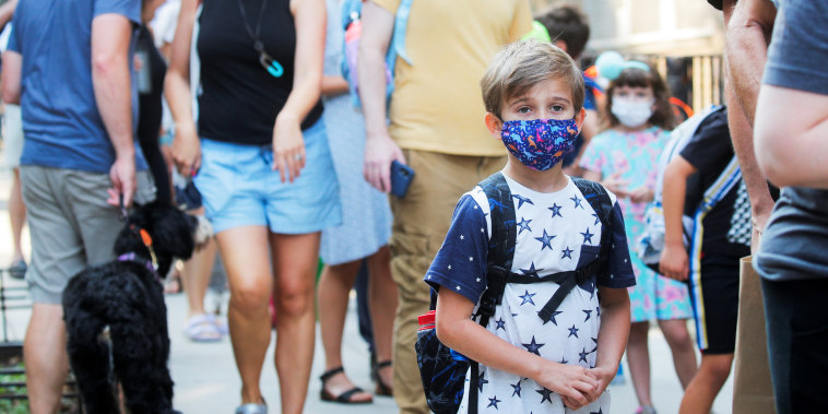 A child wears a face mask on the first day of school in Brooklyn, N.Y., on Sept. 13, 2021.