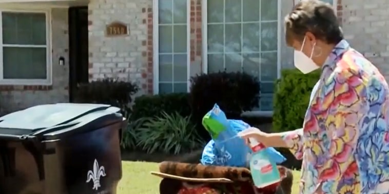 Image: New Orleans East homeowner Embra Bridges sprays bleach over her pile of trash, which she claims has not been touched since Ida hit.
