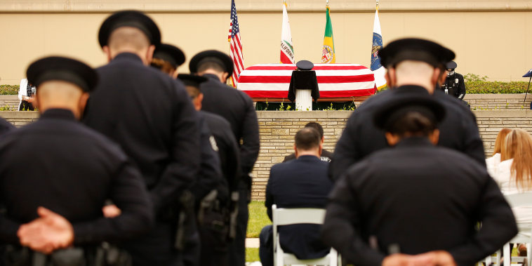 LAPD officers, family and friends attend the funeral of officer Valentin Martinez, the agency's first sworn employee to die of complications from Covid-19, on Aug. 6, 2020, in Los Angeles.