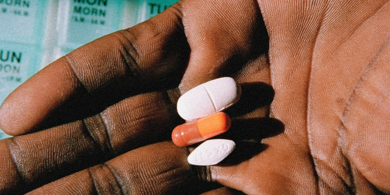 Image; An AIDS patient shows his medication in a 2004 photo.