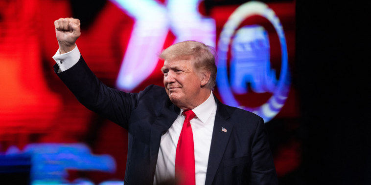 Former President Donald Trump pumps his fist as he walks off after speaking at the Conservative Political Action Conference (CPAC) in Dallas on July 11, 2021.