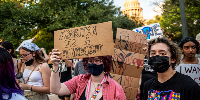 Abortion rights activists march outside the Texas State Capitol on Sept. 1, 2021, in Austin.