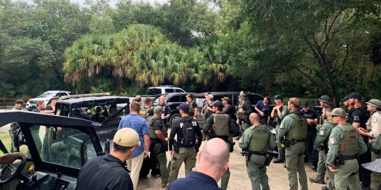 Law enforcement officials conduct a search of the vast Carlton Reserve in the Sarasota, Fla., area for Brian Laundrie on Sept. 18, 2021.