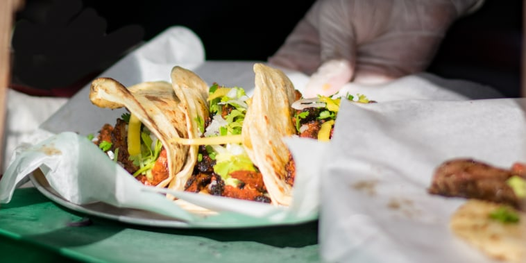 Tacos being served