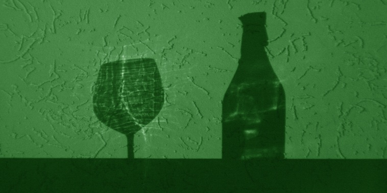 Wine bottle and glass shadow in green tone.