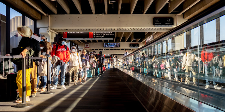 Travelers wait in line at a Transportation Security Administration screening at Philadelphia International Airport in Philadelphia on Aug. 6, 2021.