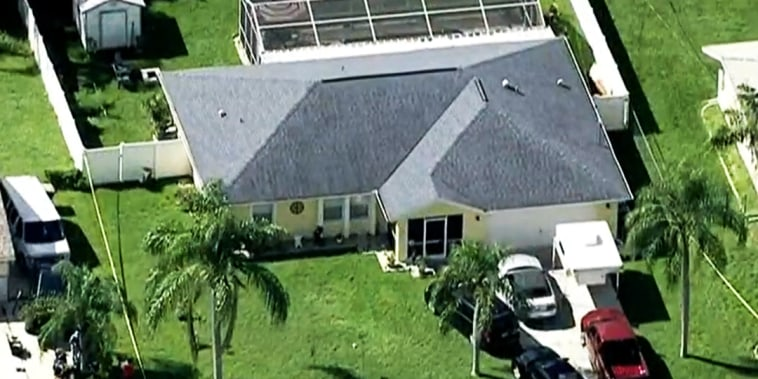 Law enforcement officials search the home of Brian Laundrie in North Port, Fla., on Sept. 20, 2021.