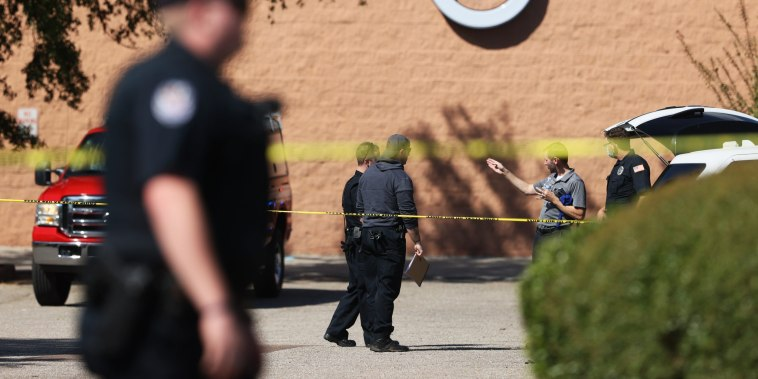 Police respond to a shooting at the Kroger location on New Byhalia Road in Collierville, Tenn., on Sept. 23, 2021.