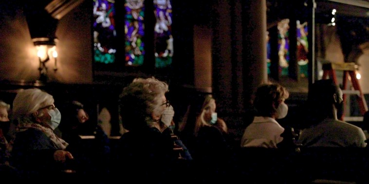 Image: Masked attendees watch The Moth true personal storytelling show live-streamed from St. Ann's Church on April 21, 2021 in Brooklyn, N.Y.