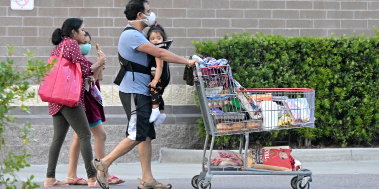 Shoppers outside a Costco Wholesale store on Sept. 5, 2021, in Orlando, Fla.