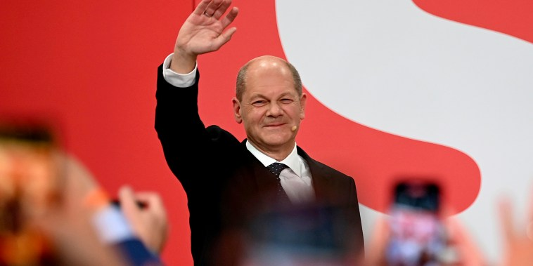 Olaf Scholz, leader of Germany's SPD party, waves during the election at Willy Brandt House in Berli on Sept. 26, 2021.