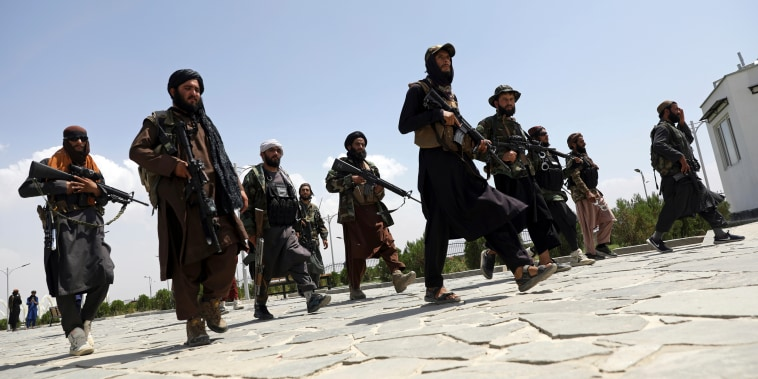 Taliban fighters patrol in Kabul on Aug. 19, 2021.