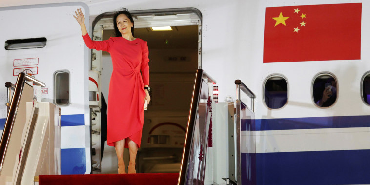 Huawei Technologies Chief Financial Officer Meng Wanzhou waves as she steps out of a charter plane at Shenzhen Baoan International Airport in Shenzhen, Guangdong Province, China, on Sept. 25, 2021.