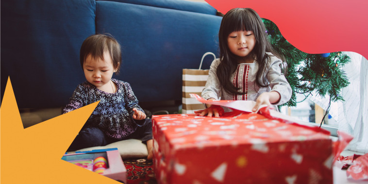 Two sisters opening presents on Christmas
