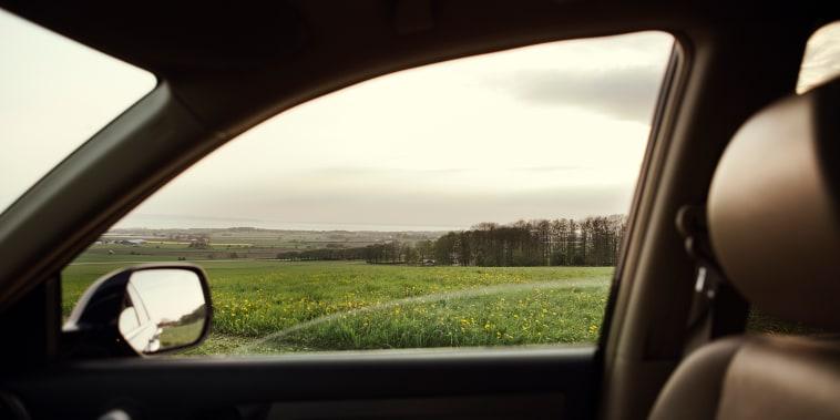 Rural landscape seen through car window