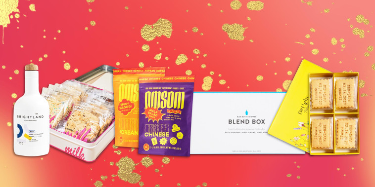 Illustration of Omsom Heat Lover's Set, Alive Brightland Olive Oil, Milk Bar The Cookie Faves Tin, Blue Bottle Blend Box and the Uncommon Goods Custom Message Shortbread Cookies