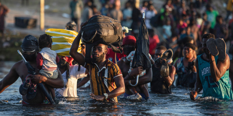 Asylum seekers, many from Haiti, wade across the Rio Grande river from Del Rio, Texas, to return to Ciudad Acu?a, Mexico, on Sept. 20, 2021, to avoid deportation from the U.S.