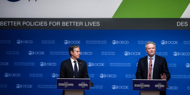 Image: Secretary-General of the Organization for Economic Cooperation and Development (OECD) Mathias Cormann, right, and U.S. Secretary of State Anthony Blinken hold a closing press conference at the 60th OECD Ministerial Council Meeting on Oct. 6, 2021,