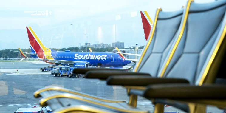A Southwest Airlines plane remains at the gate at Ronald Reagan National Airport in Arlington, Va., on May 25, 2021.