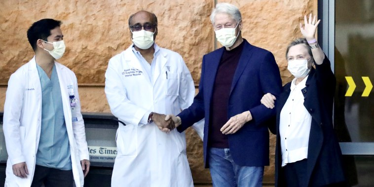 Former U.S. President Bill Clinton, accompanied by his wife, former Secretary of State Hillary Clinton, leaves University of California Irvine Medical Center, in Orange, California, U.S. October 17, 2021.