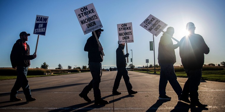 United Auto Workers picket outside of John Deere Des Moines Works on Oct. 14, 2021, in Ankeny, Iowa.