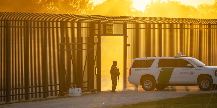 A U.S. Border Patrol vehicle drives through a gate in the border fence after U.S. Customs and Border Protection closed the point of entry with Mexico on Sept. 17, 2021, in Del Rio, Texas.