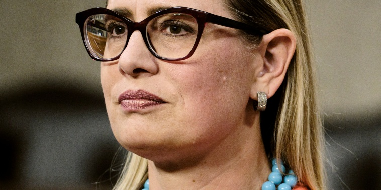 Image: Sen. Kyrsten Sinema, D-Ariz., during a news conference with fellow members of a bipartisan group of Senate negotiators on Capitol Hill on July 28, 2021.